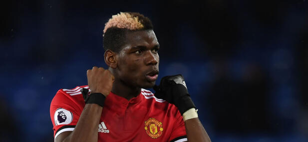 Manchester United's French midfielder Paul Pogba gestures after the English Premier League football match between Everton and Manchester United at Goodison Park in Liverpool, north west England on January 1, 2018. / AFP PHOTO / Paul ELLIS / RESTRICTED TO EDITORIAL USE. No use with unauthorized audio, video, data, fixture lists, club/league logos or 'live' services. Online in-match use limited to 75 images, no video emulation. No use in betting, games or single club/league/player publications.  /