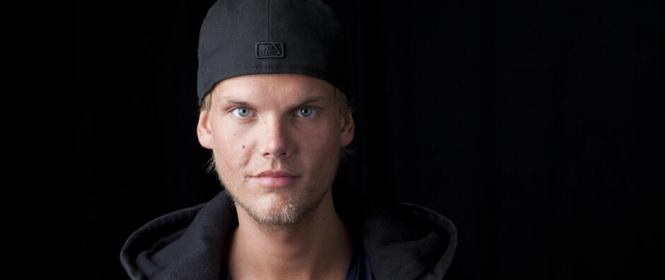 FILRE - In this Aug. 30, 2013 file photo, Swedish DJ, remixer and record producer Avicii poses for a portrait, in New York. Avicii, the Swedish DJ and producer whose real name is Tim Bergling, remained in a Miami hospital Friday, March 28, 2014, with a blocked gallbladder and could undergo surgery. The 24-year-old was hospitalized Thursday with severe abdominal pains, nausea and fever and has had to all his activities around the Ultra Music Festival, including his headlining set Saturday night. (Photo by Amy Sussman/Invision/AP, file)